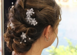 Side View Bride Hair With White Flowers Updo Lake view in background