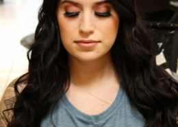 Front view of dark haired woman with long hair makeup and long eye lashes Las Vegas mobile beauty