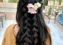 Pink and Yellow Flowers in long black hair with extensions rear view Las Vegas Mobile Beauty